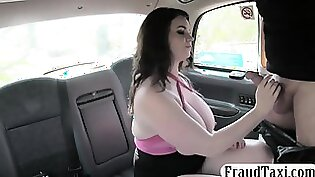 blonde lady with large boobs is in the warehouse