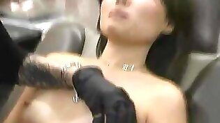 Asian girl with pierced nipples