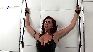 Beautiful redhead in leather boots likes to suck a big toy friend