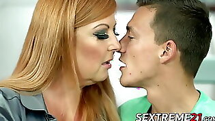 Busty redhead fucks two young guys