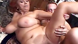 Athletic granny sucks a cock while in laws outfit