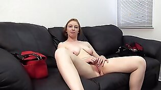 Cute redhead is swallowing a large thick cock