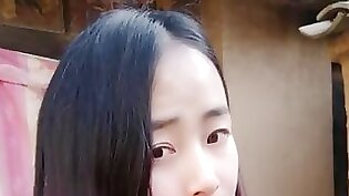 Chinese hottie Xiaoling stimulated by a high school guy